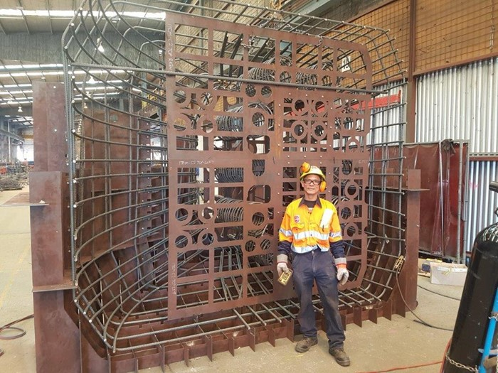 Fabricated steel cage